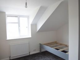 Bespoke bedframe in extended bedroom