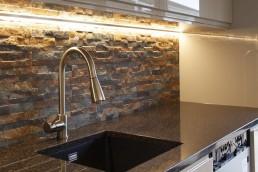 Splitface tiles & mono tap installed by Flint & Dean