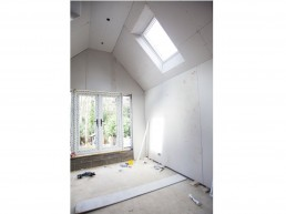 Velux windows and patio doors in the master bedroom